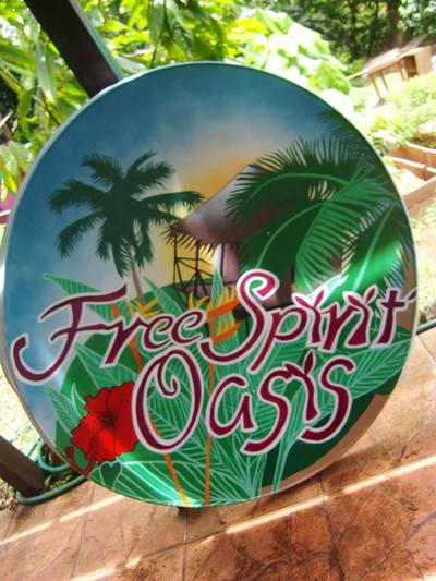 Hand painted sign with tropical island scene.
