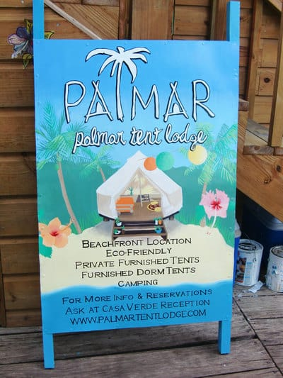 Hand painted sign with tropical beach scene in Bocas del Toro.