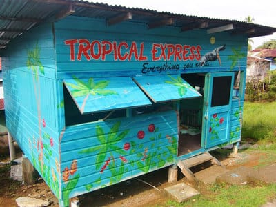 Brightly coloured restaurant with hand painted tropical design and lettering.