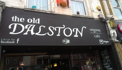 Hand painted sign and shopfront in Dalston, England.